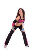Zumba teacher bending forward Stock Photography
