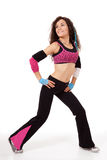 Zumba teacher in stretch pose Royalty Free Stock Photography