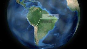 Zumbir através do espaço a um país no globo na animação de Ámérica do Sul - Bolívia - cortesia de imagem da NASA video estoque