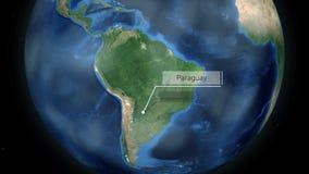 Zumbir através do espaço a um país no globo na animação de Ámérica do Sul - cortesia de imagem de Paraguai da NASA filme