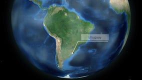Zumbir através do espaço a um país no globo na animação de Ámérica do Sul - Uruguai - cortesia de imagem da NASA video estoque