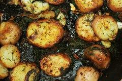 Zummi sulle patate e sulla cipolla fritte Fotografie Stock