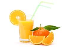 Zumo de naranja en vidrio imagenes de archivo