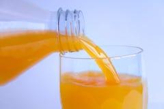 Zumo de naranja fresco Fotos de archivo