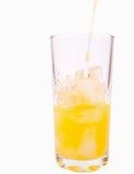 Zumo de naranja fresco en vidrio Fotos de archivo