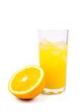 Zumo de naranja fresco en vidrio Imagen de archivo libre de regalías