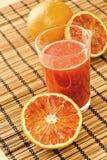Zumo de naranja siciliano fotos de archivo