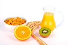 Zumo y cereales de naranja con el kiwi Fotografía de archivo libre de regalías