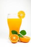 Zumo y rebanada de naranja   Imagenes de archivo