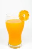 Zumo y rebanada de naranja   Fotografía de archivo libre de regalías