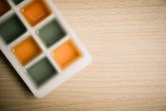 Zumos de la naranja y de manzana en estilo del vintage Fotografía de archivo