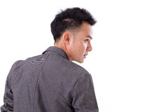 Zurück vom asiatischen Mann, der weg zu seiner Seite schaut Stockbild