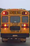 Zurück vom Schulbus lizenzfreie stockbilder
