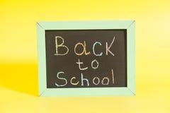 Zurück zu der Schule geschrieben auf eine Tafel Lizenzfreie Stockfotografie