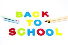Zurück zu Schulbuchstaben, -bleistiften und -kreiden Lizenzfreies Stockfoto