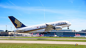 Zurich Airport. ZURICH - APRIL 14:Singapore Airlines Airbus A380 taking off on April 14, 2013 in Zurich, Switzerland. A380 is the biggest civil aircraft of the Royalty Free Stock Photos