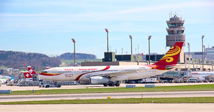 Zurich Airport. ZURICH - MAY 24:Hainan Airlines B-767 taxiing before take off on May 24, 2010 in Zurich, Switzerland. Zurich International Airport is one of the stock images