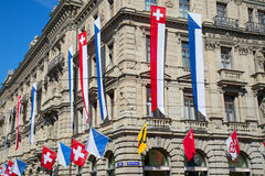 Zurich. AUGUST 1: Swiss National Day parade on August 1, 2016 in , Switzerland. Facade of Credit Suisse building decorated with national flag and flags of Stock Photos