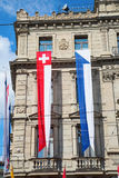 Zurich. AUGUST 1: Swiss National Day parade on August 1, 2016 in , Switzerland. Facade of Credit Suisse building decorated with national flag and flags of Stock Image