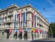 Zurich. AUGUST 1: Swiss National Day parade on August 1, 2016 in , Switzerland. Facade of Credit Suisse building decorated with national flag and flags of Royalty Free Stock Image