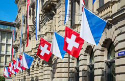Zurich. AUGUST 1: Swiss National Day parade on August 1, 2016 in , Switzerland. Facade of Credit Suisse building decorated with national flag and flags of Royalty Free Stock Photos