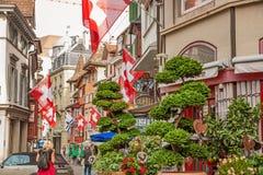 Zurich, Augustiner - Gasse, Lindenhof quarter. Zurich, Switzerland - June 10, 2017: Street Augustinergasse in Zuerich, Lindenhof quarter with swiss flags Stock Images