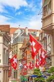 Zurich, Augustiner - Gasse, Lindenhof quarter. Zurich, Switzerland - June 10, 2017: Street Augustinergasse in Zuerich, Lindenhof quarter with swiss flags Stock Photography