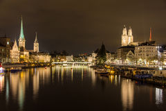 Zurich on banks of Limmat river at winter evening.  Stock Photography