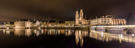 Zurich on banks of Limmat river at winter evening Stock Image