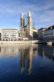 Zurich cathedral reflecting in the river. Grossmuenster church reflecting on the river Limmat in Zurich Royalty Free Stock Images