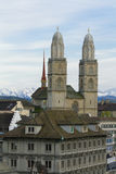 Zurich city. Zurich Cathedral. Aerial view over Zurich Cathedral with Swiss Alps in the background. Grossmuenster Stock Photos