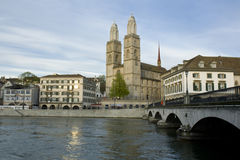 Zurich city. Zurich Cathedral. Panoramic view over Limmat river. Zurich Cathedral. Muenster bridge, Muensterbruecke Royalty Free Stock Photos