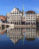Zurich cityscape with Central Library tower. Zurich, Switzerland - March 20, 2014: view across the Limmat river with the Central Library tower, the University Stock Photography