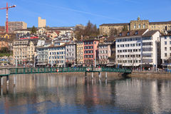 Zurich cityscape in early Spring. Zurich, Switzerland - March 20, 2014: view across the Limmat river with the Central Square on the left side and the University Stock Images