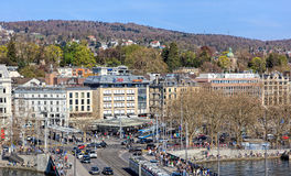 Zurich cityscape in spring. Zurich, Switzerland - 10 April, 2016: pedestrians and traffic on Quaibruecke bridge and Bellevue square, view from the Ferris wheel royalty free stock photo