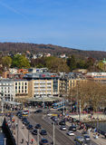 Zurich cityscape in springtime. Zurich, Switzerland - 10 April, 2016: pedestrians and traffic on Quaibrucke bridge and Bellevue square, view from the Ferris royalty free stock image