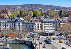 Zurich cityscape. Zurich, Switzerland - 11 April, 2016: pedestrians and traffic on Quaibruecke bridge and Bellevue square, view from the Ferris wheel temporarily royalty free stock images