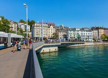 Zurich cityscape. Zurich, Switzerland - June 30, 2018: buildings of the historic part of the city of Zurich along the Limmat river, people and traffic on the royalty free stock photo