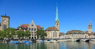 Zurich cityscape. Zurich, Switzerland cityscape: Stadthaus, Lady Minster and St. Peter Church decorated with flags for the Swiss National Day August 1 Royalty Free Stock Image