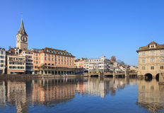 Zurich cityscape. Zurich, Switzerland cityscape in winter. The Limmat river, St. Peter Church and the Zurich Town Hall (German - Rathaus Royalty Free Stock Image