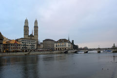 Zurich with Grossmunster cathedral. Grossmunster cathedral, Zurich, behind river Limmat Stock Image