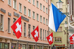Zurich, Hotel Storchen with swiss flags and zuerich flag Royalty Free Stock Image