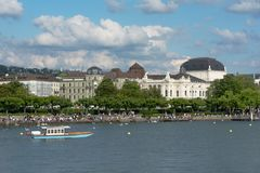 Zurich lake with boat. View of historic Zurich city center with Zurich Opera House, Switzerland Stock Image