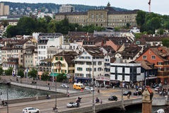 Zurich landscape. Zurich city, Switzerland - shore of river Limmat. View to the old part of the city. Many tourists visit this one of the most expensive European Stock Photography