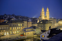 Zurich by night. Grossmunster in the old town of the city of Zurich, Switzerland. River Limmat in front Royalty Free Stock Photos