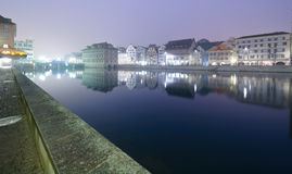 Zurich at night. View of Zurich and old city center reflecting in the river Limmat at night Royalty Free Stock Image