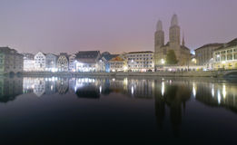 Zurich at night. View of Zurich and old city center reflecting in the river Limmat at night Stock Photo