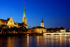Zurich at night. Night view of Zurich historical center with towers over the river Royalty Free Stock Photo