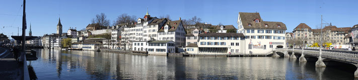Zurich Old Town Panorama. Zurich - Switzerland, April 15, 2013: Panorama view of Zurichs old town on the left side of river Limmat with the towers of Fraumunster Royalty Free Stock Images