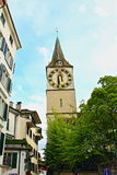Zurich Old town street Switzerland. View of a Altstadt narrow street with St Peter`s church clock tower.The historic heart of Zurich, the Altstadt, or Old Town Stock Photography